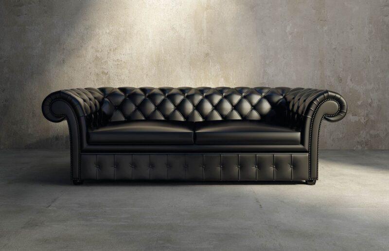 pavimento in cemento e divano