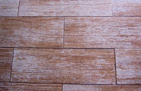 Priorità piastrelle di sfondo con piastrelle esagonali marrone